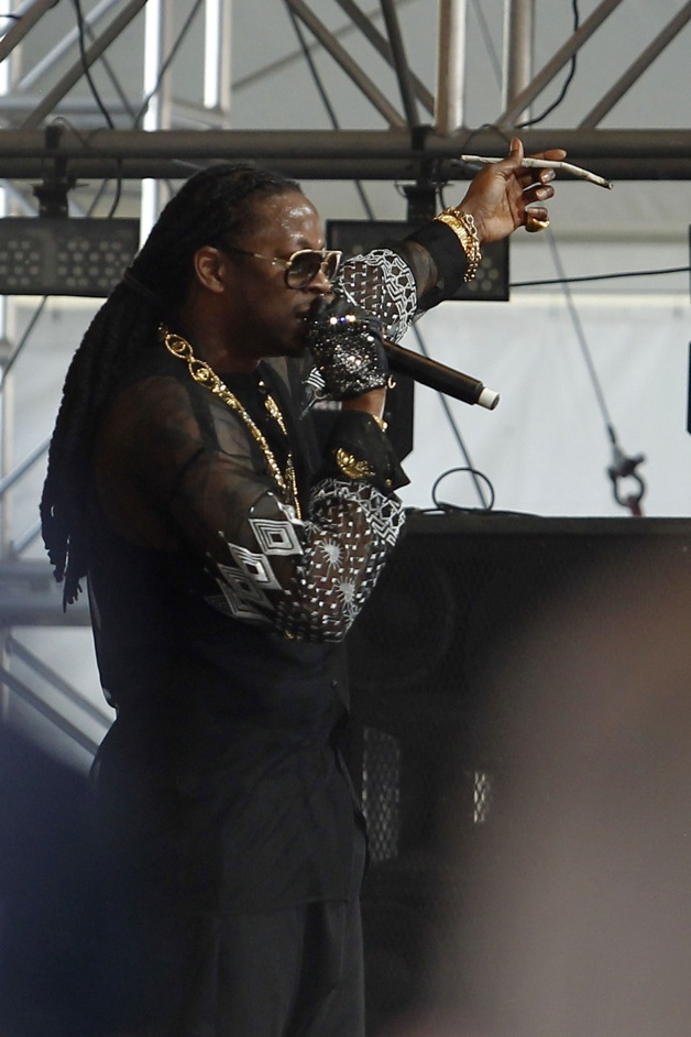 WHOA!! 2 Chainz performs on 4/20 with a giant joint in his hand accompanied by Pete Wentz of Fall Out Boy at the Coachella Music Festival in Indio