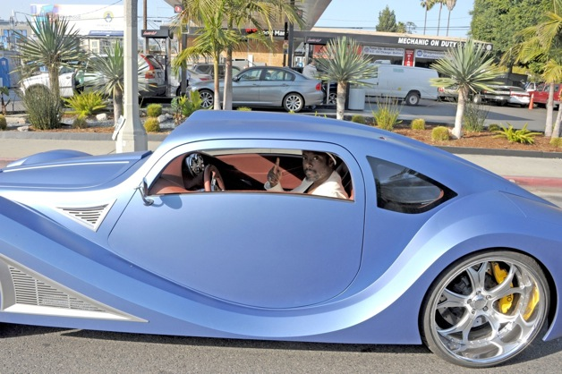 Will.i.am drives around Los Angeles in a futuristic car