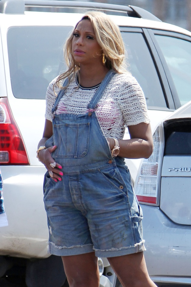 EXCLUSIVE** Tamar Braxton shows off her growing baby bump in overall ...