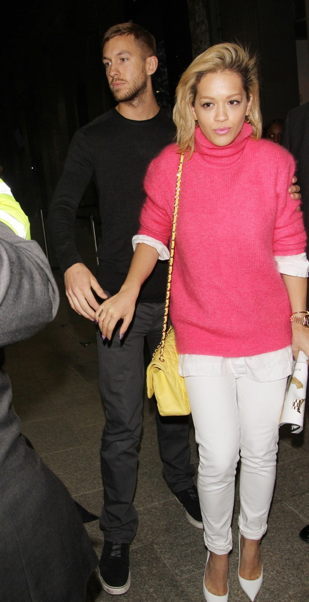 Rita Ora and Calvin Harris leaving hand-in-hand The Shard after attending 'Daft Punk's' new album launch party in London