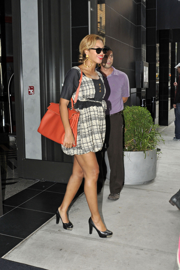 A preggers Beyonce shows off her growing belly in a cute ruffled dress as she leaves the Gansevoort hotel in NYC