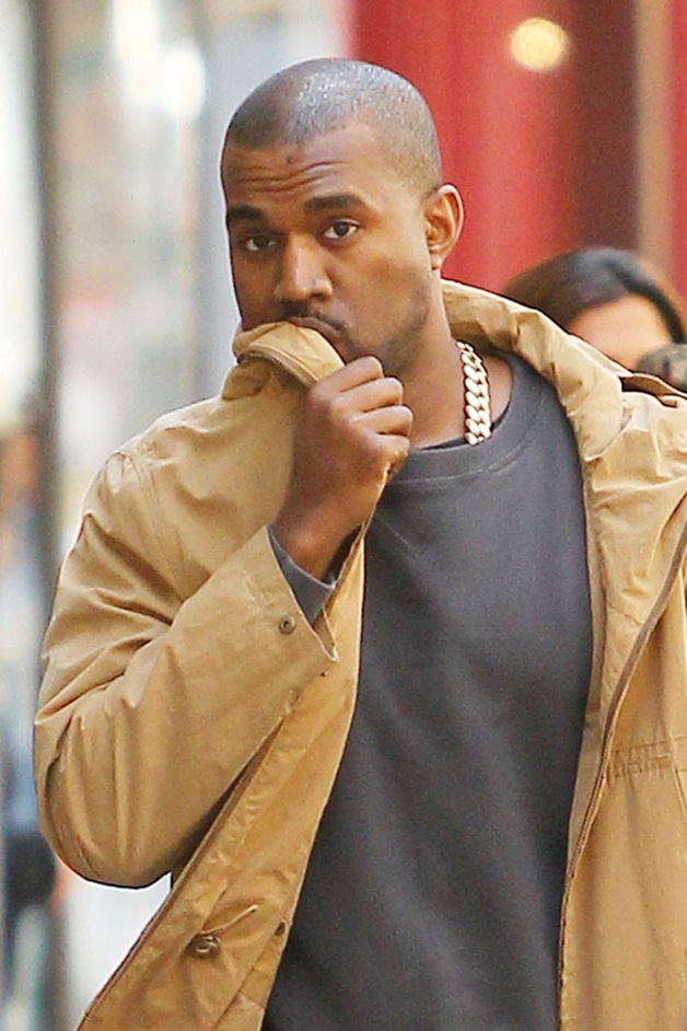 **EXCLUSIVE** The bump on Kanye West's forehead appears to be healing as he is seen out for a stroll in NYC