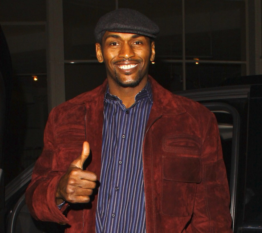 Metta World Peace, Los Angeles Lakers player, gives a big thumbs up after a victory earlier in the evening against the Clippers