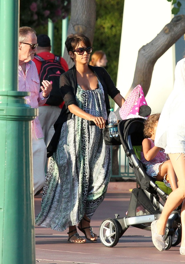 Halle Berry is seen showing off her baby bump as she takes daughter Nahla to Disneyland in Los Angeles