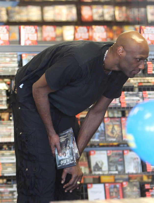 Lamar Odom heads to a Blockbuster for some movies after getting some food to go in Los Angeles