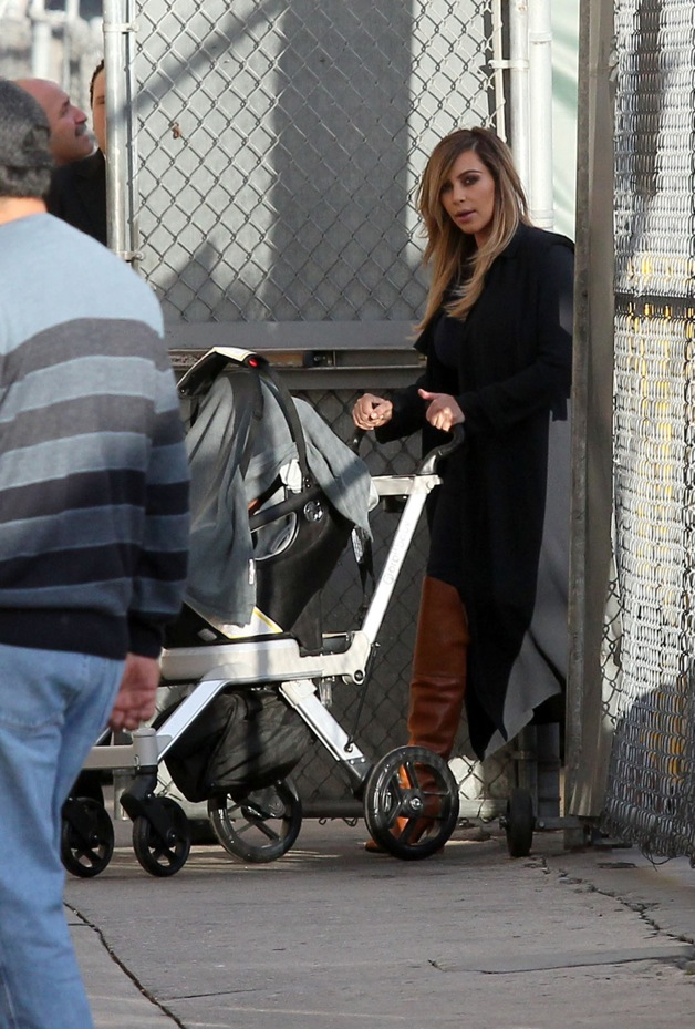 Kim Kardashian pushes baby North around in a stroller while out and about in Los Angeles