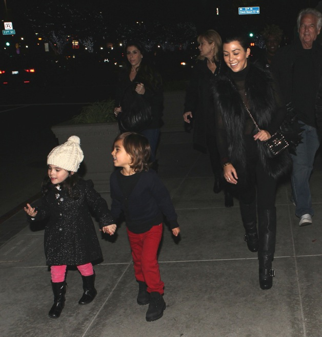 Kourtney Kardashian and her son Mason Disick seen at Staples Center in Los Angeles