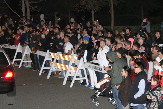 People gather to pay respect at Paul Walker's crash site in Santa Clarita