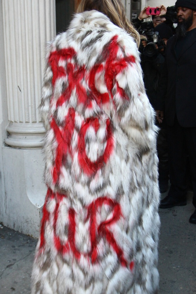 """Khloe Kardashian's coat reads """"'Yo Fur&quor"""" as eads tods to the Dash store with sisters Kim and Kourtney in NYC"""
