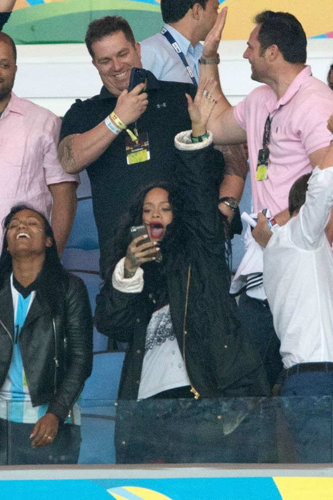Rihanna parties in the stands of the Maracana stadium during the final soccer match of the 2014 World Cup in Brazil