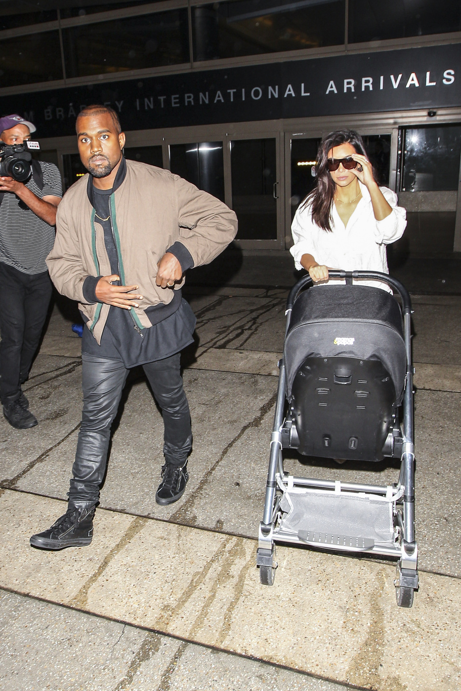 Kim Kardashian, Kanye West and daughter North West make their way through LAX after flying in from Australia