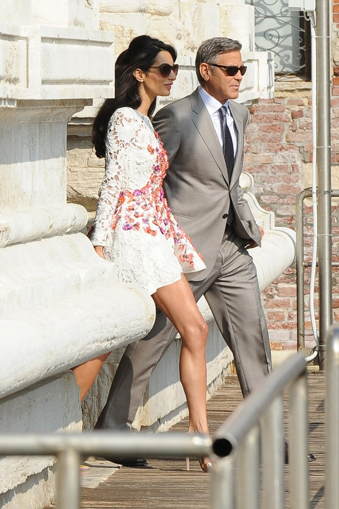 George Clooney and his wife Amal Alamuddin step out of The Aman Canal Grande hotel after the wedding night in Venice