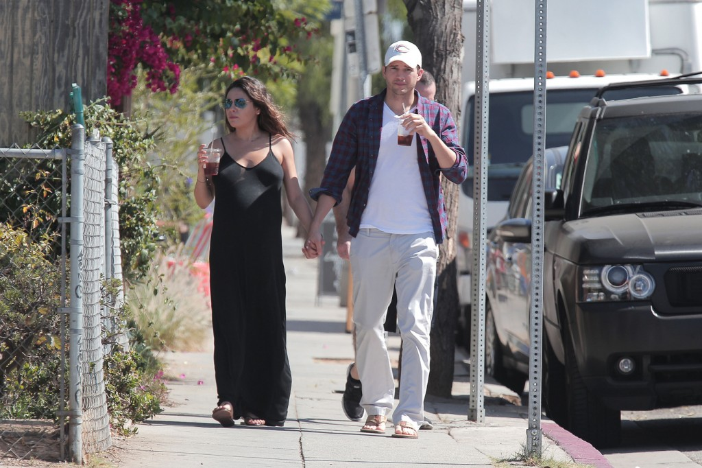 EXCLUSIVE: Ashton Kutcher and very pregnant Mila Kunis walk hand in hand down the street after grabbing ice tea from Flake in Venice