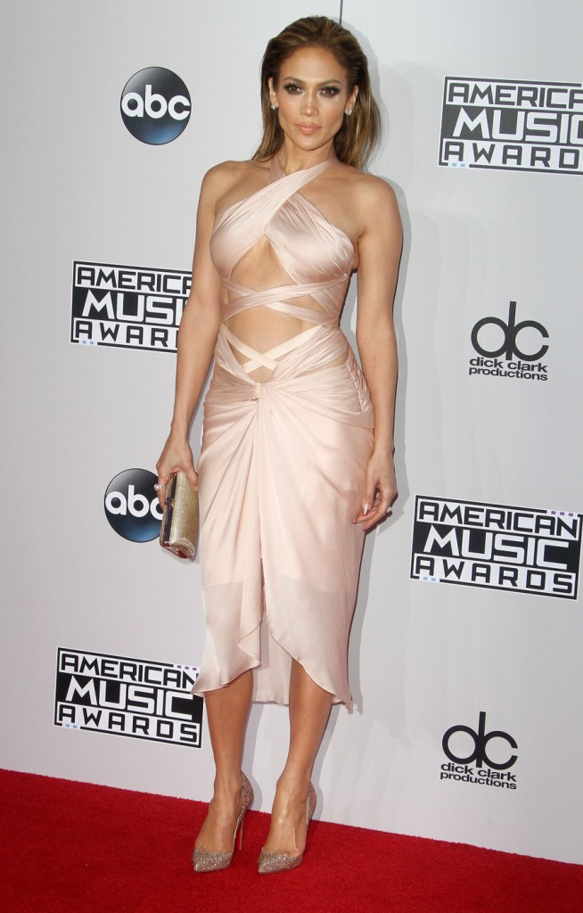 Jennifer Lopez displayed her toned body in this neutral colored dressed.