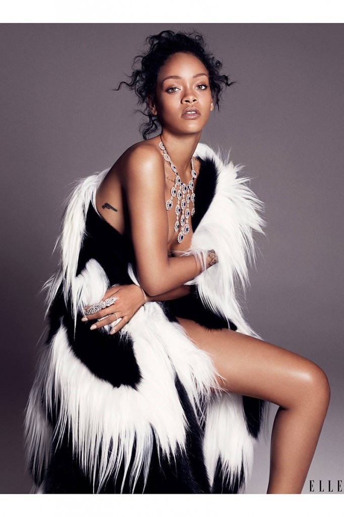 Rihanna looks gorgeous in this Giambattista Valli cape and rocking her own ring.