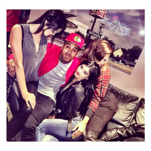 Kendall took a seat on Chris' lap.