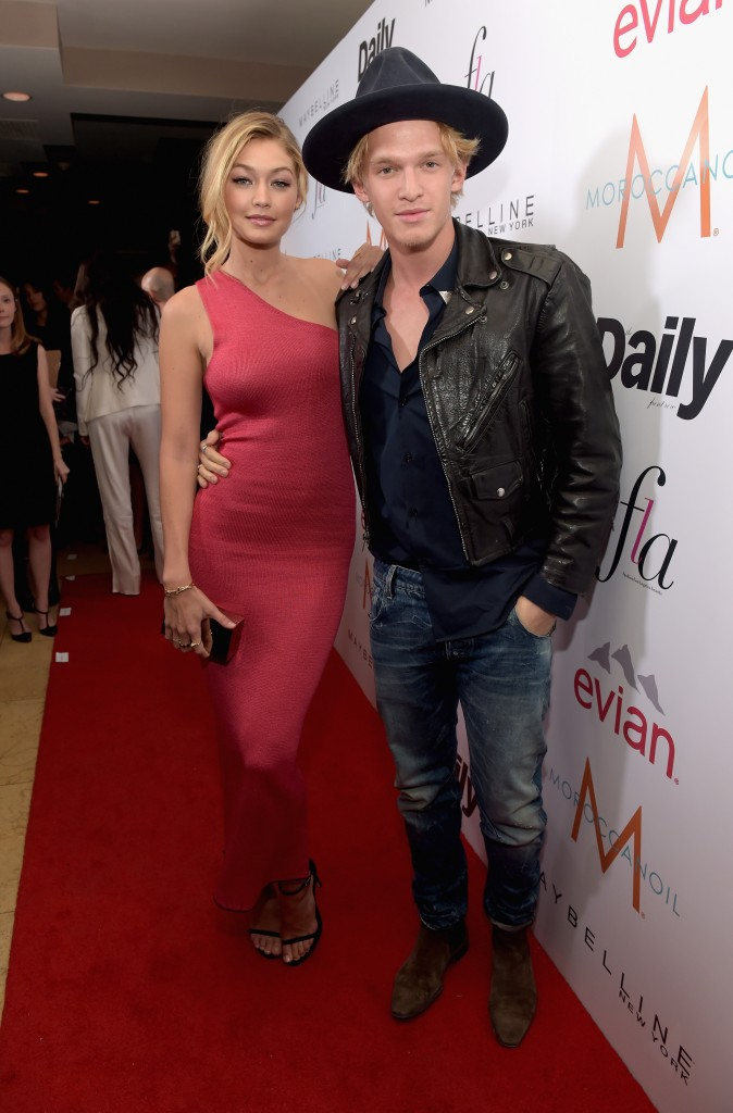 """WEST HOLLYWOOD, CA - JANUARY 22:  Honoree Gigi Hadid (L) and singer Cody Simpson attend The DAILY FRONT ROW """"Fashion Los Angeles Awards"""" Show at Sunset Tower on January 22, 2015 in West Hollywood, California.  (Photo by Jason Kempin/Getty Images for the DAILY FRONT ROW)"""