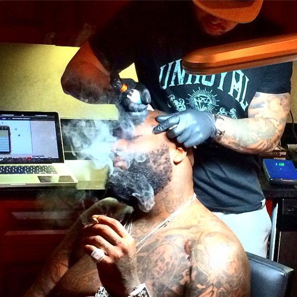 Getting face tats looks hella painfully, but Rick Ross takes it like a BAWSE!