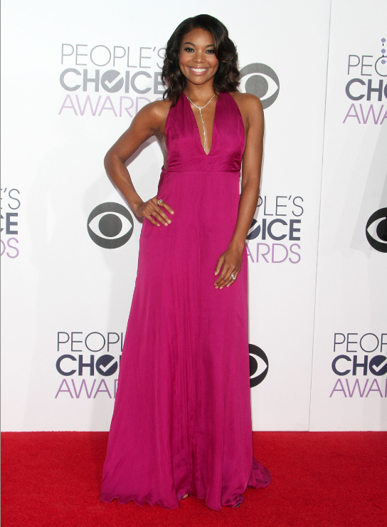Dressed by Rachel Zoe, Gabrielle Union stunned in this magenta Honour gown that showed off her tone arms and back.