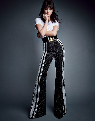heory cotton T-shirt, $85; Theory stores. Balmain embellished flared trousers and belt; Bergdorf Goodman, NYC. Jill Heller Jewelry ring.