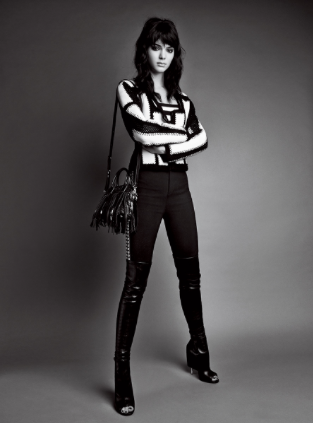 Givenchy knitted jacket with crocheted detail, striped bodysuit, and canvas-and-leather pants ($3,990); jacket at Saks Fifth Avenue stores and pants at Neiman Marcus stores. Versace fringed handbag.