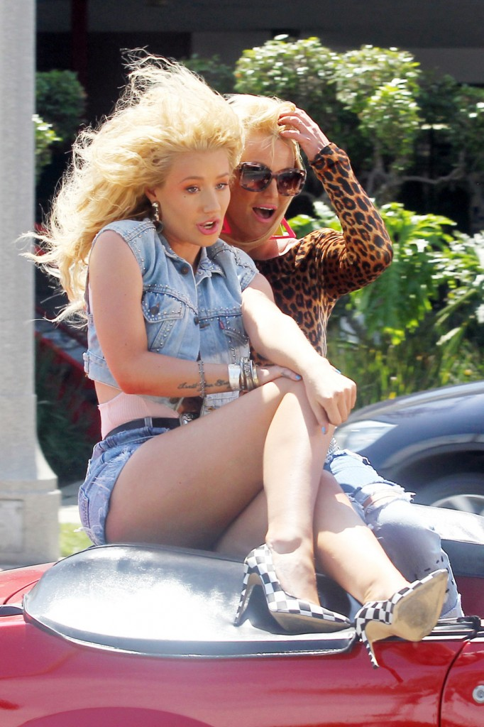 Britney Spears and Iggy Azalea sit on top of a classic 80s convertible while filming the music video for their new song 'Pretty Girls'
