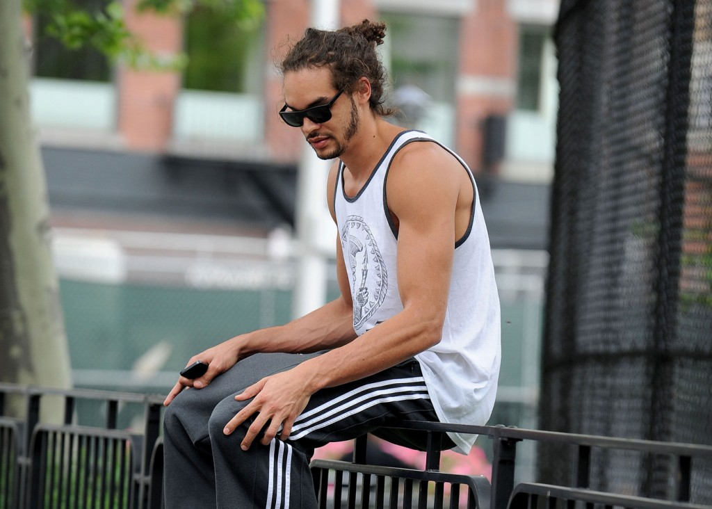 97318, **EXCLUSIVE** NEW YORK, NEW YORK - Thursday May 23, 2013. Chicago Bulls basketball player Joakim Noah relaxes on a fence with no shoes on in the West Village, New York City. **FRANCE, AUSTRALIA & NEW ZEALAND OUT** Photograph: © Hector Valllenilla, PacificCoastNews.com **FEE MUST BE AGREED PRIOR TO USAGE** **E-TABLET/IPAD & MOBILE PHONE APP PUBLISHING REQUIRES ADDITIONAL FEES** LOS ANGELES OFFICE: 1 310 822 0419 LONDON OFFICE: +44 208 090 4079