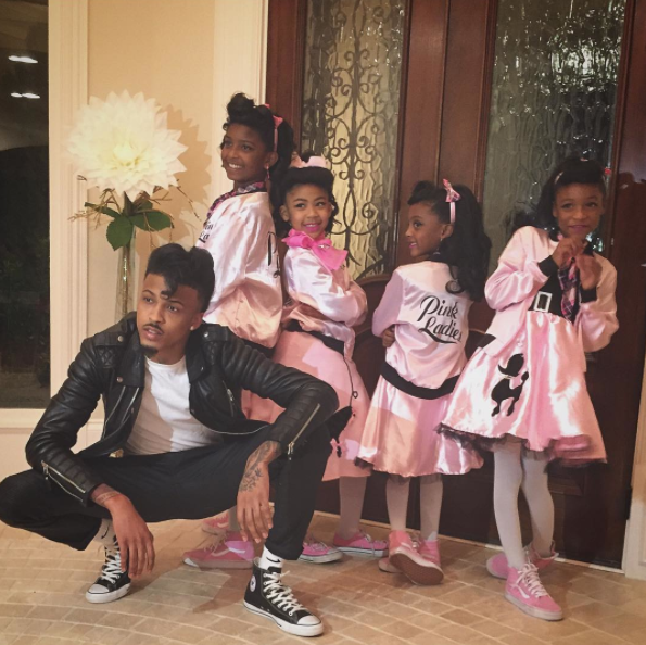 August Alsina and his nieces dressed as cast of 'Grease.'