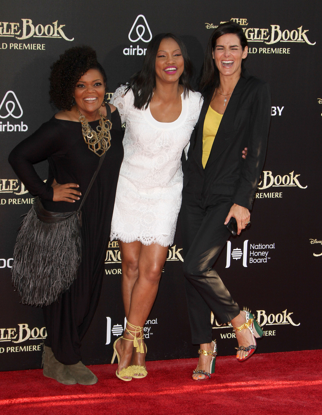 Garcelle Beauvais and Angie Harmon attend the premiere of 'The Jungle Book ' at El Capitan Theater, Hollywood