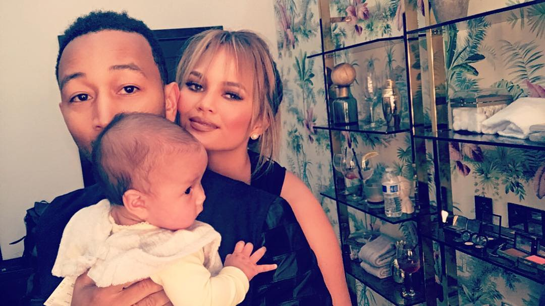 John Legend takes baby girl to visit wife Chrissy at work.