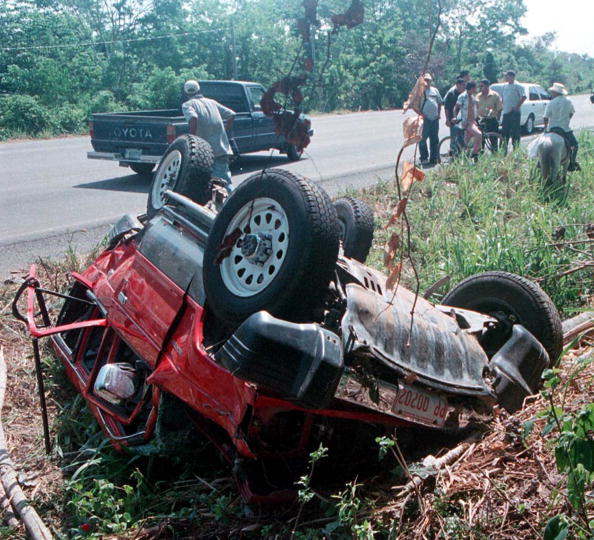 """404531 03: The wreckage of a sport utility vehicle that was carrying singer Lisa """"Left Eye"""" Lopes, a member of the Grammy-winning trio TLC, lies upside down April 26, 2002 in Jutiapa, 150 miles north of the Honduran capital of Tegucigalpa. Lopes, 30, was killed the night before when the vehicle flipped off the road and overturned. Lopes was vacationing when the accident happened. (Photo by Getty Images)"""