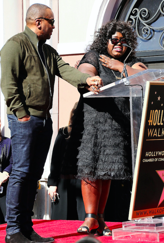 Gabourey Sidibe joins Film Producer Lee Daniels on stage as he receives a star on the Hollywood Walk of Fame. Hollywood, California - Friday December 2, 2016.